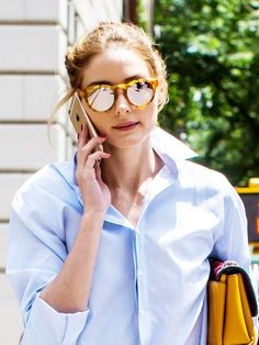 Olivia Palermo in NYC. Blue shirt, yellow clutch.