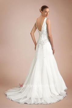 Beaded V-neck, v-back  http://www.weddingdresstrend.com/en/sweet-hot-sale-pale-yellow-wedding-dress-with-tempting-v-necks-and-beautiful-motif-detail.html