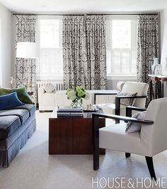 If you'd like to distract from your home's hot water radiators, but can't box them in permanently, consider hanging curtains in a pretty print to draw the eye up and away.    Designer: Tara Fingold  Photographer: Donna Griffith