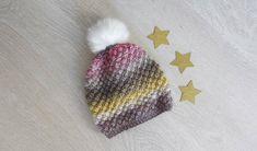 Bonnet tricoté main au point d'astrakan pour bébé 12/18