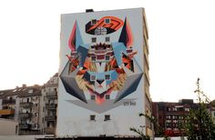 Street Art power-duo Low Bros spent a few days working on this massive piece which is featuring one of their signature geometric characters. The duo consists of two brothers, Qbrk and Nerd, born in Hamburg, northern Germany. Make sure to take a peep at more images by Artkissed after the jump and if you are in Cologne, you'll find the piece on #Barbarossaplatz.