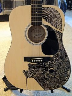 wow! I have a guitar just like that one - It is so boring! Maybe I should do something like this with it?