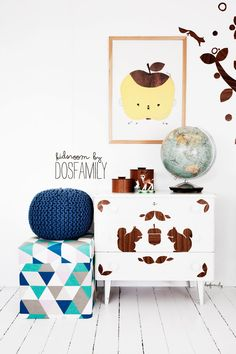 Dosfamily. DIY self adhesive tree and a decorated chest in our kidsroom.  The wooden floor and the walls were already white. The chest of drawers is also decorated with vinyl squirrels. Apple picture from Fine Little Day.