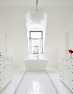 Romantic white bathroom with pop of blue