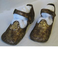 Tudor style shoes decorated with brown and gold glitter and gold sequins