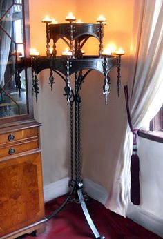 This company makes custom wrought iron chandeliers. Floor standing, table top, traditional and more.