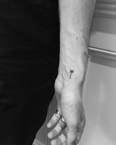 Minimalist palm tree tattoo on the left inner wrist. Tattoo...