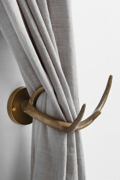 Magical Thinking Antler Curtain Tieback - Urban Outfitters --- We have these in our front 'sitting' room and they're a lot nicer than I would have thought given the price.