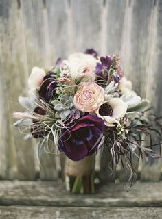 Deep eggplant, gray and brown wedding bouquet.