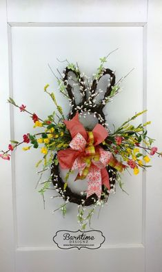 Bunny rabbit all decked out for Easter. Cute bunny hanger to brighten your decor. #bunny door hanger #Easter wreath, #Easter bunny #bunny decor #moss rabbit #Easter rabbit #home decor ideas #spring decor #spring Easter decor