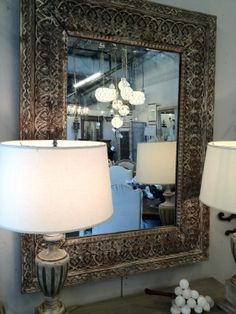 Great carving around this mirror.