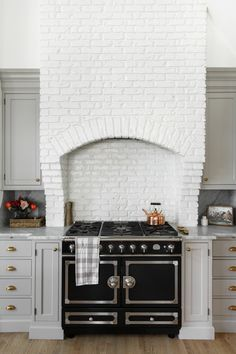Our Oak Street project is complete and we are sharing some photos from the kitchen remodel. Take a peak! Kitchen Interior, Kitchen Design, Kitchen Decor, Kitchen Ideas, White Quartzite Countertops, White Brick Backsplash, 1920s Interior Design, White Wash Brick, Oak Street