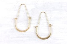 """Small, lightweight hoops in hand-forged 14K gold-fill or sterling silver, 1 1/4"""" long"""