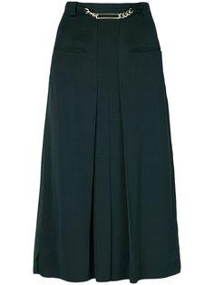 Shop Carven pleated high-waisted skirt.