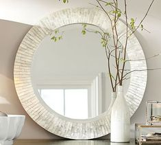 Miranda Capiz Round Mirror #potterybarn.   Another mirror option for above Buffett in dining room