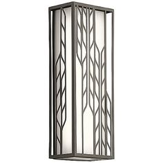 The Magnolia LED Outdoor Wall Lantern by Kichler is a standout transitional piece that provides style as well as function to outdoor settings. Its seamless Etched Cased Opal glass shade is accented by a detailed, feather-like framework. The light plays nicely through the design, creating artistic contrasts between lit and unlit surfaces, while illuminating the surrounding space.