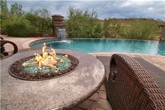 Create a tropical paradise in your backyard with this elegant granite fire pit! Order this tropical Sunscape Oriflamme fire pit online from AllBackyardFun. Backyard Seating, Fire Pit Backyard, Backyard Patio, Backyard Landscaping, Backyard Ideas, Porch Ideas, Patio Ideas, Outdoor Ideas, Camping Gaz