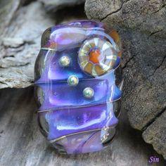 Handmade glass lampwork bead by Sin.
