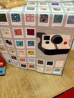 """Polaroid quilt - I totally want this!  I would use key pieces of fabric for the """"pictures.""""  Who wants to make me one?"""