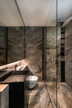 In a small bathroom, using the same tile on the floor and walls make the space appear bigger. The large mirror helps too.