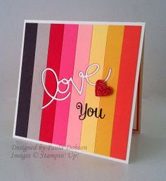 Cut strips of cardstock in the colours you want to use and adhere them side by side on a piece of copy paper.