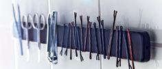 Magneetlijst gebruikt om haarspelden en nagelknippers aan te hangen