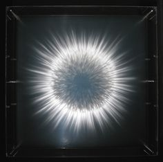 David Spriggs paints in three dimensions. His work is composed of acrylic paint and transparent plastic sheets spaced out and viewed through the built up layers. Here, you can see abstract shapes, patterns, and galaxies that appear to magically glow and hover in place.