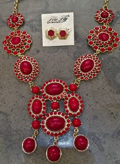 VaVaVoom! Who doesn't need a signature red necklace?