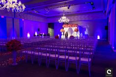 The W Hotel funky pink & purple flowers Hoopah ballroom ceremony. By Cory Ryan Photography. http://www.coryryan.com