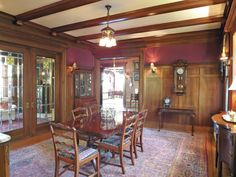 The beam details in this dining room are a nice deep color. Nice detailing with the way they meet the crown molding too. The grain in the wainscoting seems odd.    An Epic 1912 Portland Estate