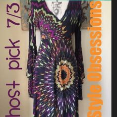 Missoni long sleeve dress Beautiful and in excellent condition.. Vibrant colors.. Dress is knee length.. Sleeves are long sleeves and bell sleeve combination..US size 10.. Smoke free and pet free home.. Bundle your order and save 20%!! Missoni Dresses Midi