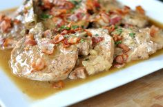 Pork chops smothered in bacon gravy! I made this in a pan instead of a slow cooker, and it was glorious.