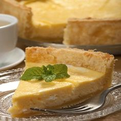 Creamy Lemon Coconut Tart - The filling is rich and creamy and haupia-like.  The combination of lemon and coconut are divine!