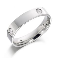 Superb contoured wedding ring set with 4 diamonds. Available in 9ct gold, 18ct gold, palladium 950 and platinum 950. Width 5mm