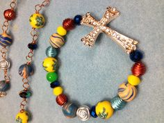 Multi color rose gold cross bracelet. Loved the bright yellow, metallic blue and rust color pop.