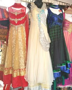 Boutique Designer #indianoutfits. Red and Gold  5 layer beige and silver #indiandesigner dress with attached duppatta  High low black green blue with green and blue stone work  available only at Bibi's Fashion.