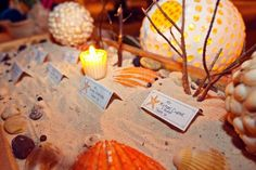 Seating cards placed in a sand bar for a beach wedding