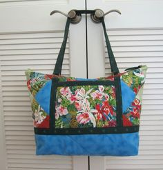 handmade quilted purse Large quilted two strap handbag in a batik floral print multiple bright colors on a brown background