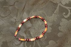 Yellow Mother-of-Pearl Ovals with Red and Brown Wood Beads Bracelets