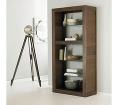Bentley Designs Akita Walnut Open Display Unit Taking inspiration from contemporary design and Oriental styling, this stunning Bentley Designs Akita Walnut Open Display Unit features glass shelves which complement the rich walnut veneers beautifully. An eye-catching storage solution which is sure to impress.