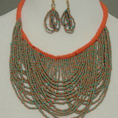 Statement necklace! This coral and turquoise necklace has a 4 inch drop. The earrings have a 1 1/ 2 inch drop. Jewelry Necklaces