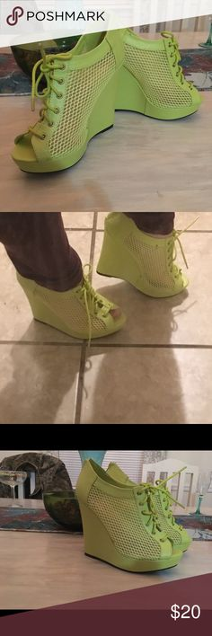 Neon green wedges Neon green wedges that have a fishnet kind of allure! Summer type wedge that brings a bit of subtle sexiness to your daytime dresses or date night dancing is a breeze in these! Lace up front with zipper back for easy on/ off. Worn once no visible blemishes that I can see quipid Shoes Wedges