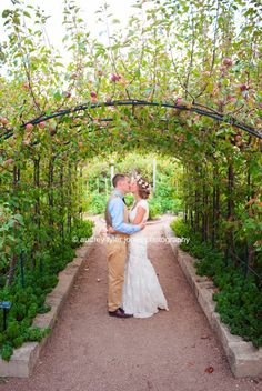 """""""My best friend got married"""" at the Reiman Gardens:  Ames, Iowa; Iowa State University, bride and groom kissing, arch, poses, weddings, couples, romantic,  © audrey tyler jones photography"""