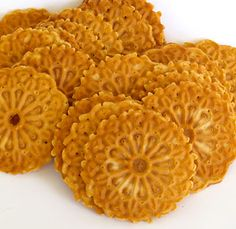 Pizzelle are thin, crispy Italian cookies made particularly at Easter and Christmas. http://www.cooksinfo.com/pizzelle