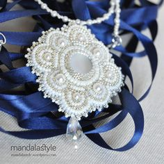 https://www.etsy.com/listing/197426553/gold-ivory-bead-embroidery-bridal?ref=related-0