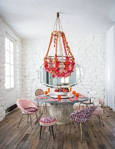 Cool eclectic brilliance in pink feminine dining room with chandelier as centerpiece    @pattonmelo