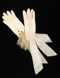 Leather gloves with silk and organdy trim, by Moyen, American, ca. 1880. Worn with a silk wedding dress with cotton organdy ruffles.