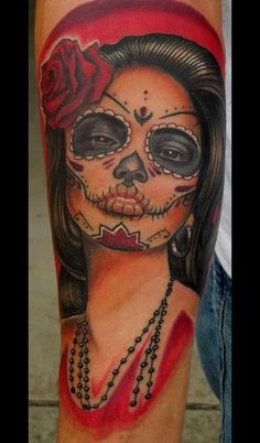 I would never get a tattoo this large, but I think this is so beautiful. I LOVE day of the dead skulls.