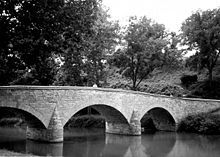 Burnside's Bridge is a landmark on the Antietam National Battlefield near Sharpsburg, Maryland. Crossing over Antietam Creek, the bridge played a key role in the September 1862 Battle of Antietam during the American Civil War when a small number of Confederate soldiers from Georgia for several hours held off repeated attempts by elements of the Union Army to take the bridge by force. Finally, the Federals seized it ... (wikipedia)