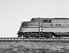 IC, Tolono, Illinois, 1960 Illinois Central Railroad diesel locomotive no. 4001, one of the road's earliest passenger units, racing northward with the Creole passenger train near Tolono, Illinois, on April 2, 1960. Photograph by J. Parker Lamb, © 2015, Center for Railroad Photography and Art. Lamb-01-035-04